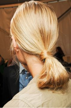 "CAROLINA HERRERA SS12 - ""Centre-parted ponytails were tucked into a knot at the nape of the neck. "" (Vogue)"