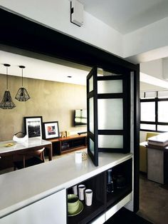 install a folding screen above the bar counter so you can have the choice of opening or closing up the kitchen area