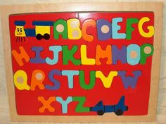 ABC Train Puzzle $35.00 - Help kids learn their ABCs with this well made fun wooden train puzzle!