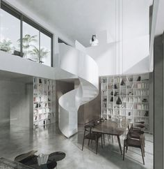 ZŁOTA 3 ROOFTOP EXTENSION, WARSAW | white steel spiral staircase, minimal design, high ceiling, wood, bookcases