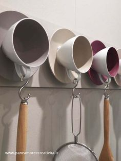 man this is too cool, and easy and cute, cute so damn cute. Fancier cups would be cool for a bedroom. Color theme for the bathroom. Cups from places you have visited? I'm an idea person~JN