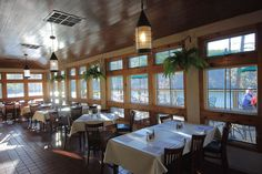 Dine inside in the intimate enclosed porch with lake views at the Lakeview Restaurant at Douthat State Park