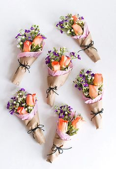 When it comes to meaningful gifts, giving flowers is always a safe bet. Add a little twist to the traditional gift idea by miniaturizing your bouquets! Bunch a few of your favorite flowers, cut them to the desired length, tie together, add a little bit of tissue paper and kraft paper and tie with string for a super cute and simple gift.