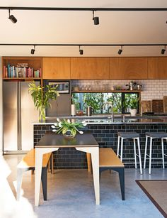 When a little state house is kitted out with a modern addition, it's a yin and yang arrangement that suits this young family perfectly