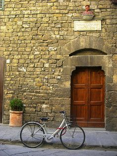 I want to ride on a cute little bicycle or Vespa around Italy.