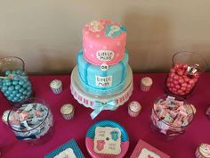 Cake and treats at a gender reveal baby shower party! See more party planning ideas at CatchMyParty.com!
