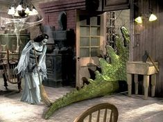 Lily Munster sweeps the kitchen as Spot the Dragon leaves the room on the CBS horror comedy series THE MUNSTERS The Munsters, Munsters Tv Show, Munsters House, Munsters Grandpa, Cult Movies, Horror Movies, Films, La Familia Munster, Los Addams