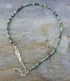 Hey, I found this really awesome Etsy listing at https://www.etsy.com/listing/215859442/african-turquoise-mermaid-necklace