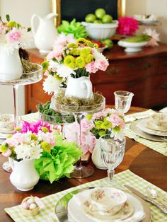 Arrange inexpensive grocery store flowers, such as mums, daisies, alstromeria or carnations, in simple, tightly clustered bouquets placed in small ironstone pitchers. Stack arrangements on glass cake pedestals of various heights for added impact.
