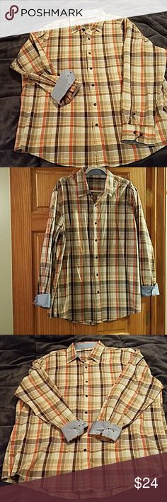 Mens dress shirt plaid XL Very classy men's dress plaid shirt in orange and brown with light blue accents. Worn once in excellent condition. Classic and not slim fit. Reasonable offers accepted and I bundle with any others in my for discount. Thanks for looking and sharing. Tasso Elba Shirts Dress Shirts