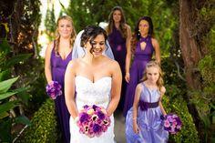 Gorgeous shot of the bride and her bridesmaids in purple   @Brett Benham of Brett & Tori Photographers