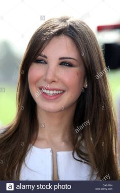 Download this stock image: Dubai, United Arab Emirates, Nancy Ajram in portrait - D30HWN from Alamy's library of millions of high resolution stock photos, illustrations and vectors.