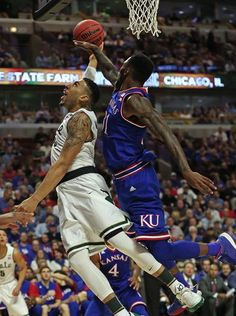 Denzel Valentine drives to the basket past Kansas' Jamari Traylor during the Champions Classic at the United Center on Tuesday.  Jonathan Daniel Getty Images