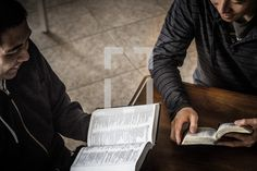 Two men reading at a Bible study.