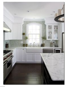 love the green subway tile and marble counters!
