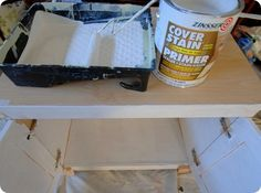 LAMINATE CABINETS: It's key to invest in the right primer designed to adhere to glossy surfaces. ZINSSER is best oil-based primer.  Oil-based Zinsser grips like glue without sanding. Water-based Zinsser requires sanding + long dry time.  Roll your primer on the furniture, then follow up with a brush in all the crevices.  This primer dries really fast, but if you want a longer time to work with your primer and minimize brush strokes, use an additive called PENETROL