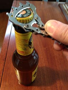 Recycled bike parts bottle opener.