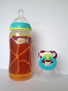 10 oz Nuk Giraffe Animal Print reborn baby bottle with fake juice plus Nuk giraffe magnetic pacifier.
