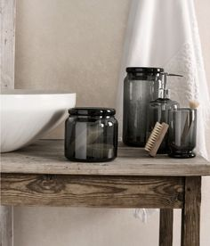 Make a Match  Make a Match Store Q-tips and cotton balls in these smoked-glass lidded jars to add a unifying and just-a-touch-masculine note to your bath.  Glass bathroom accessories, $6.95 and up.
