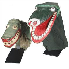 "Alligator Hand Puppets  USA  20th century  Alligator Theatrical Puppets  Painted wood with cloth  Early 1900's  Maine  Alligators were essential to any  good Punch and Judy show.  17"" x 8"" , 12"" x 5""  Price  $3,500"