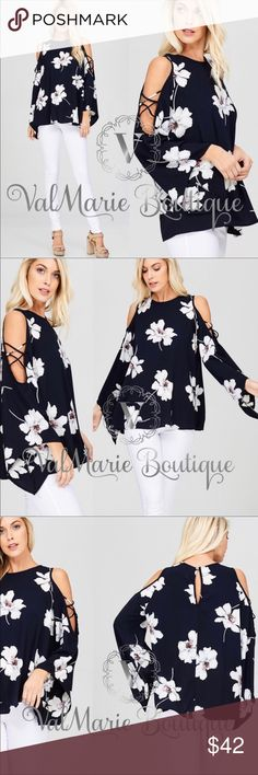 Navy Floral Top 🇺🇸MADE IN USA- these gorgeous tops are a dark navy color with a gorgeous Floral print. 100% soft spun polyester. Such a trendy design and casual fit. S(2-4) M(6-8) L(10-12) ValMarie Tops