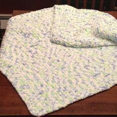 Knit baby blanket with seed stitch border. Uses Bernat Baby Blanket yarn.