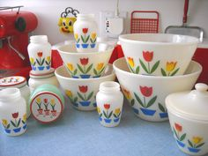 "Fire-King ""Tulip"". I coveted these for years. Finally got the bowls, enjoyed them for a while, then sold them. My boyfriend surprised me with the grease jar, which I'm never selling. :-)"