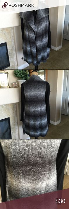 """🆕 Listing Chico's Tunic Knit Vest This looks much cuter on than my photos portray! This is an ombré knit vest in shades of gray. There is a slight ruffle that cascades down the front. Measuring across the back, the bust measures approx 32"""". The length measures approx 31"""". I wore this with leggings and boots. It looked great open or belted. Although I have worn this, it is in excellent condition. 58% Acrylic, 17% Polyester, 15% Wool. See size chart towards the top of my closet. Chico's…"""