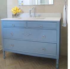 A second hand cabinet turned into a bathroom vanity.