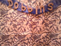Tapestry Photobooth Backdrop for Our Wedding - I know I Need to Iron It Still - The Letters are Cardboard Wraped in Twine