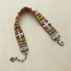 CROSS COUNTRY BRACELET. Hand loomed, a sterling silver-tipped bracelet of brass, Japanese Miyuki and Czech fire-polished beads recalls prairie skies and green fields.