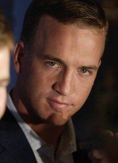 Peyton Manning.  I don't even like football, but I have a mad crush on him