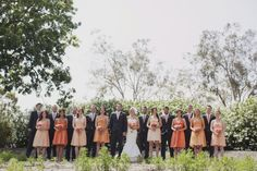 Large bridal party, girls in front pose