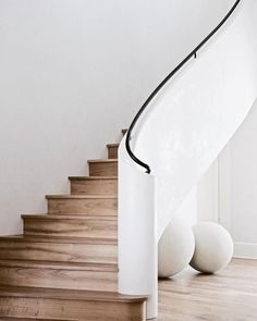A beautiful modern staircase with white plaster walls and wooden treads and rise. : A beautiful modern staircase with white plaster walls and wooden treads and risers. We love the black steel railing detail and the curve of the stairs! Interior Stairs, Home Interior Design, Interior Architecture, Staircase Architecture, Steel Stairs, Steel Railing, Black Railing, Staircase Railings, Curved Staircase