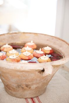 floating apples with tea candles for fall weddings