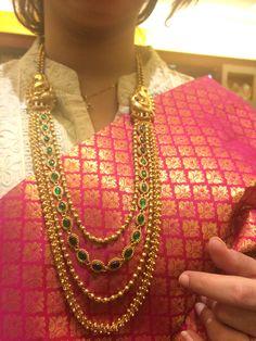 Simple yet outstanding temple jewellery with elegant kanjivaram silk saree