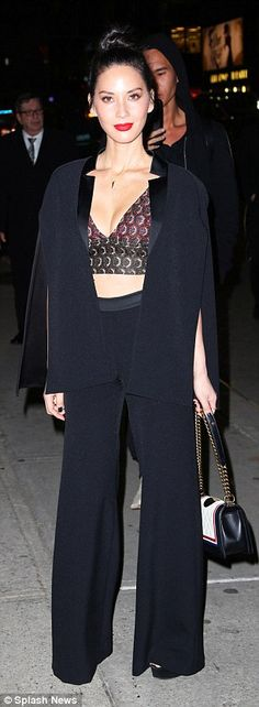 Chic in the city: Olivia matched her stylish and revealing outfit with a tri-colour bag and topknot hairdo