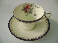 1940's Aynsley corset shaped cream and cobalt cup and saucer with flowers, Aynsley flowers teacup and saucer, Aynsley corset flowers teacup