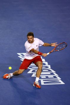 Stanislas Wawrinka of Switzerland plays a backhand in his men's final match against Rafael Nadal of Spain during day 14 of the 2014 Australi...