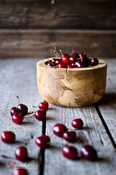 Ripe cherries in a wooden bowl of simplicity.