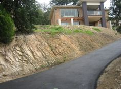 driveway cuts into earth