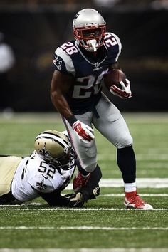 New England Patriots vs. New Orleans Saints - James White #28 of the New England Patriots is brought down by Henry Coley #52 of the New Orleans Saints during the third quarter of a preseason game at the Mercedes-Benz Superdome on August 22, 2015 in New Orleans, Louisiana.