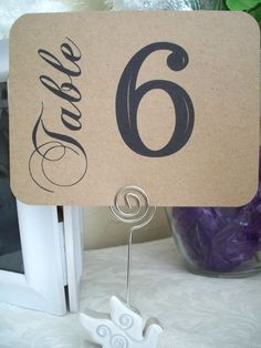 I like the word table printed in different font and vertical to the horizontal number - table number ideas Wedding Seating, Wedding Table Numbers, Table Wedding, Word Table, Diy Wedding, Wedding Ideas, Wedding Photos, Nautical Wedding, Wedding Favors