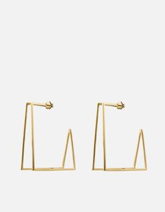 Hovering over the idea of an axis point, the line in which the Earth rotates, we created the geometric gold vermeil Axis earrings for women. Taking inspiration from modern ideals, the structured piece is bound to turn heads. [tab]Specifications[/tab]Base Metal: Sterling Silver Plating: 18k Yellow Gold Dimensions: L: 2 in x W: 3/4 in x H: 2 in Designer Earrings, Designer Jewelry, Gold Hoops, Gold Studs, Designing Women, Women's Earrings, Jewelry Design, Sterling Silver, Plating