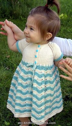 Free Knitting Pattern for Sunday Best Baby Dress - This dress knitted seamlessly from the top down with easy lace skirt with adaptable length. Sizes 12, 18, 24 months. Designed by ABC-Knitting-Patterns.com. Sport weight yarn.