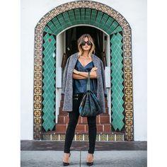 Black jeans, navy tee, gray coat.
