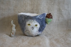 Julie Whitmore pottery. Love her characters. Lucky to have a mug by her.