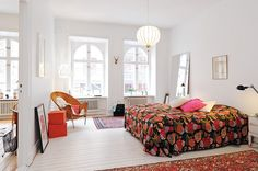 floral bedspread, white floors, & lantern