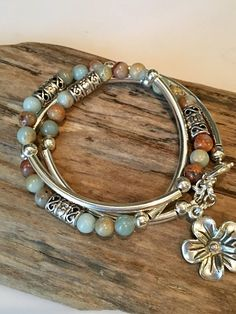This Stunning Bohemian Style Bracelet/Necklace will be noticed and adored! Beautiful colors made with Aqua Terra Impression Jasper beads and silver tube beads! There are detailed textured Tibetan style tube beads throughout! Its made to wrap around your wrist three times and