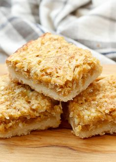 Grandma's Coconut Chews  Chewy coconut filling layered onto a buttery shortbread crust. This recipe is so simple to make, I have been making it since I was a child. This is my grandma's recipe, if you are a coconut lover, these can not be beat.